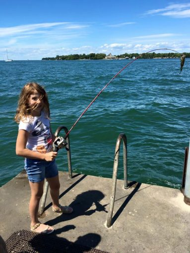Girl fishing on pier at Massie Cliffside Preserve
