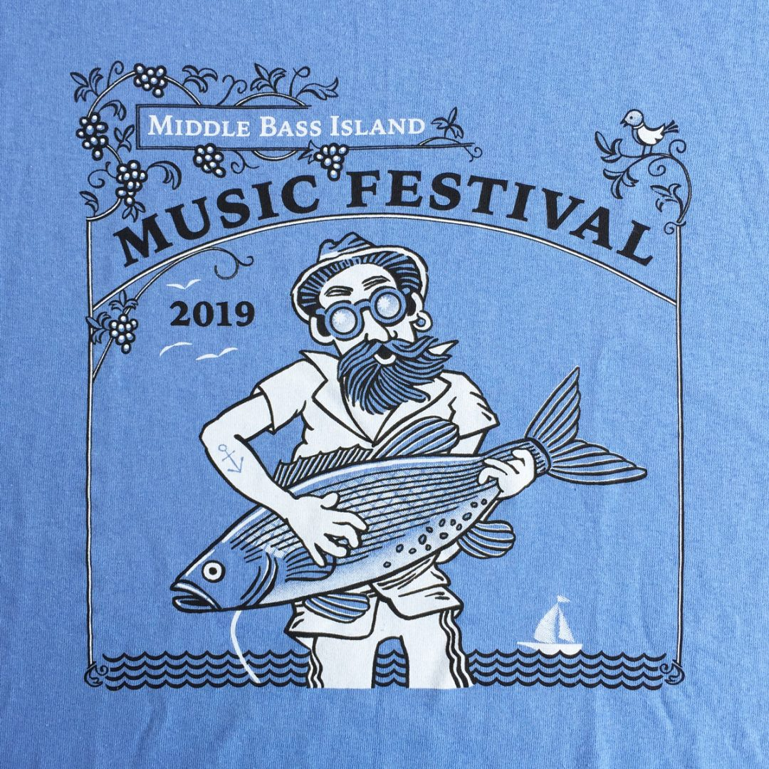 Blue t-shirt with 2019 Middle Bass Music Festival graphics.